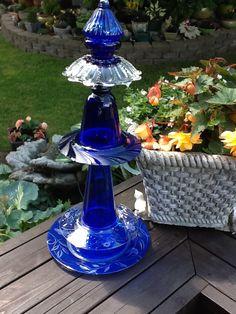 Tabletop size blue glass totem.