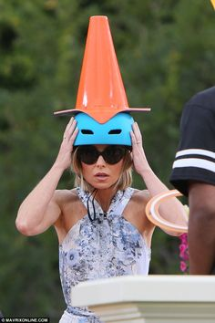Fun: Game for a laugh TV host Kelly Ripa got stuck in with the entertainment at the park, ...