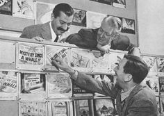 Walt shows Nelson Eddy and Jerry Colonna a peek at the storyboard.
