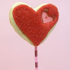 STAINED GLASS HEART COOKIE POPS ~ If you let these cookies dry overnight, you can wrap them as favors or for Valentine's Day gifts. Just slip a cellophane bag over the cookie and tie with a ribbon.
