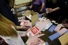 About 35 volunteers helped package Heroin/Opioid Overdose Rescue Kits in a storage room at MyHouse, a homeless youth center in Wasilla on February 9, 2017. (Marc Lester / Alaska Dispatch News)