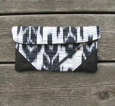 leather clutch, black & white woven cotton, fold-over clutch. $35.00, via Etsy.