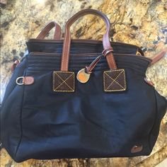 Dooney and Bourke purse in very decent condition. Black with hot pink Bags Shoulder Bags
