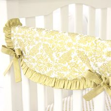 This Gold and White Damask Crib Rail Cover is made by Caden Lane. We love the look of the gold ruffle!