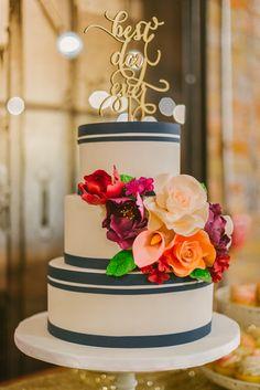 striped wedding cake - photo by Olive Photography http://ruffledblog.com/winter-garden-wedding-in-toronto #weddingcake #cakes #caketopper