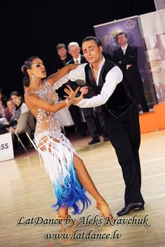 1st Place Latvian Latin Championships 2012 - [unique skirt design - possibly a feather/color pattern for a smooth dress?]