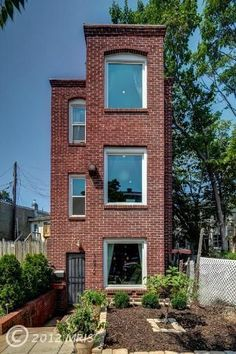 This brick beauty in Washington has the proportions of a supermodel, all height and little width. Listed for $549,999 by Tom Lewis of Redfin, the 2-bedroom, 1.5-bath row-house-without-a-row somehow manages to look surprisingly roomy and modern, thanks to some clever interior customization. The floor