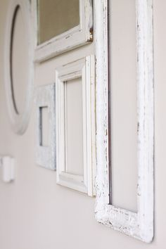 (ok, maybe not this one.. ) a wall of antique white frames. i love them.