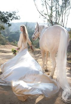 Wow getting ready for the wedding, I guess her horse is walking her down the aisle? Or  maybe she is marrying her horse? Anyways it is a beautiful photo.