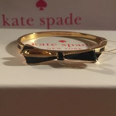Kate Spade Bracelet New Kate Spade Bow Bracelet/Bangle Color: Black/Gold/ White No free shipping. Price is firm. No trades Includes dust bag, shopping bag, and gift box. kate spade Jewelry Bracelets