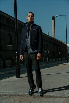 """Going casual, Paul F. models a Lanvin """"New Wave"""" embroidered jacket $1,075 and turtleneck sweater $355. He also rocks a Lanvin plaid shirt $495, trousers $460, and high-top leather sneakers $546."""