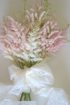 Astilbe wedding bouquet soft pastel pink fluffy florals & lace bound bouquet. Created by Blush Rose Manchester wedding florist.