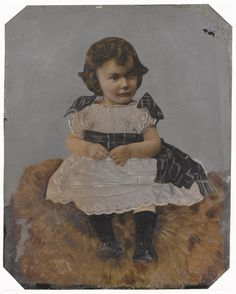 Whole plate heavily tinted tintype, depicting a seated child wearing a lace dress with a tartan sash, mounted, by an unknown photographer, 1870s - 1890s