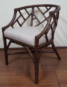 "Top Pick #4 by Jennifer Brouwer www.jenniferbrouwerdesign.com Kenian  Chippendale Club Chair   Chippendale Club Chair, Kenian item #226MH,  Premium Rattan, Leather wraps in a rich Mahogany finish. (W22 x D25 x H30"") #HPmkt"