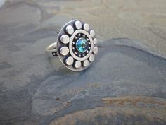 Flower Ring with Peacock Topaz by SashaBellJewelry on Etsy