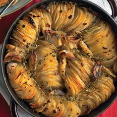 Crispy Potato Roast Recipe | Martha Stewart - trying to fit shallots in seemed to be too much of a PIA, sprinkled a little garlic and onion powder on it instead.