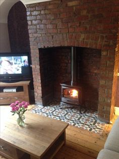Wood burning stove and tiled hearth. Fire Is a Tiger Classic Stove and tiles are… Wood burning stove and tiled hearth. Fire Is a Tiger Classic Stove and tiles are from Tiles in Stockport. Fireplace Hearth Tiles, Wood Burner Fireplace, Cosy Fireplace, Brick Hearth, Brick Fireplaces, Inglenook Fireplace, Wood Stove Surround, Chimney Breast, Living Room Inspiration