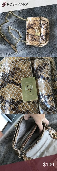 "Micheal Kors ""snakeskin"" leather cross-body bag. Micheal Kors gorgeous ""snakeskin"" leather cross-body bag. Great like new condition! I wore this a handful of times and then it just sat in my closet. It really makes a statement, perfect condition. Micheal Kors Bags Crossbody Bags"