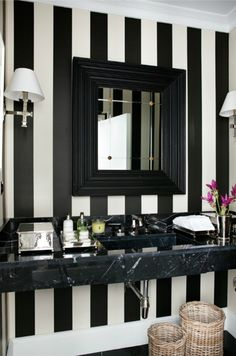 source: Luis Bustamante Chic black and white bathroom with black marble floating washstand with black beveled mirror. Black and white striped bathroom wallpaper, polished nickel sconces and woven bathroom baskets. Black Marble Bathroom, Black White Bathrooms, Marble Wall, Bathroom Small, Bathroom Modern, Masculine Bathroom, Guest Bathrooms, Marble Top, Master Bathroom