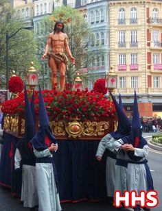 Semana Santa, Spain.  American students often see the head coverings and ask are they part of the KKK?!  No, they are NOT!  They are penitents, suffering voluntarily for their sins.  The head covering keeps their identity anonymous because their sin is between them and God...not them, God and all the chismosos in the neighborhood.  The shape and length of the head garment makes it difficult to determine the penitents height, thus adding to their anonymity.