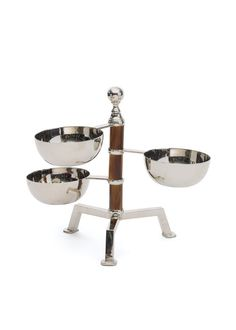 In a polished nickel finish, this Tiered Bamboo Serving Stand lends a stylish and sophisticated element to your serving table.  Also is perfect for serving snacks and condiments in the home bar.