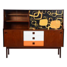 Teak Sideboard with Colored And Graphic Veneer | From a unique collection of antique and modern sideboards at http://www.1stdibs.com/furniture/storage-case-pieces/sideboards/