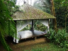 Resting pavilion next to a river in Bali.  Great idea for gathering place for an outdoor school.