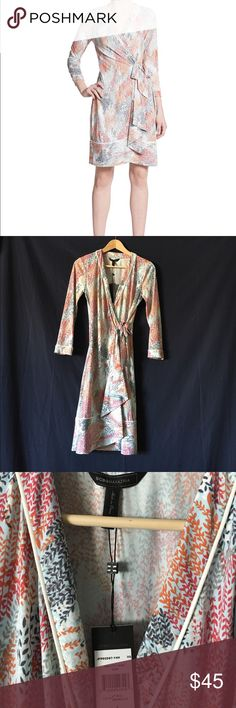 BCBMaxAzria wrap dress NWT. BCBGMAXAZRIA City Shirt wrap dress in light blue smoke color. Beautiful grey, red, and rust fall floral pattern. Size small (too large for me by about two sizes, but I never got around to returning it...offers welcome) Polyester/spandex mix. Long sleeved. Originally $178, never worn, tags attached. BCBGMaxAzria Dresses