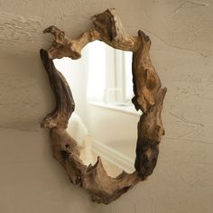 Awesome organic shaped mirror - made from a tree root and great way to bring a touch of earthiness into your home.