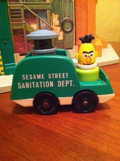 Oscar the Grouch and Bert cruise around in their sanitation truck. From the Fisher-Price Sesame Street Play Set.