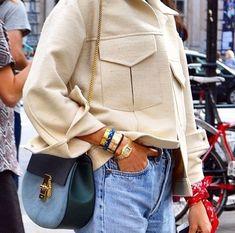 That jacket + blue bag