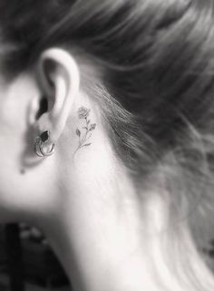 Behind-the-ear floral tattoo by Doctor Woo