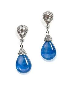 Burmese (Myanmar) sapphire and diamond earrings composed of inverted pear-shaped rose-cut diamonds surrounded by a frame of brilliant-cut diamonds, suspending a further diamond and pavé-set diamond cap, all surmounting a drop-shaped sapphire, weighing 24.86 carats in total. Mounted in 18k white gold. Length 3.2cm. Photo by Bonhams. Sold for HKD 144,000 in 2011.