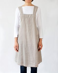 Item description This A-line apron dress was made with medium-weight linen and features two pockets on the sides. Just slip it over your head and it will nicely wrap around you. It crosses in the back and is very comfortable to wear as there are no straps constraining your neck. It offers ample coverage, ideal for when you need to protect your clothes. Material 100% Medium-weight natural linen Linen is a natural fabric made of flax fibers and it is known for its durability and long life. It…