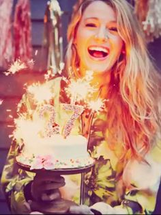nice pose while holding a birthday cake.. | but then again it's Blake Lively.. the always look gorgeous is probably her trait..