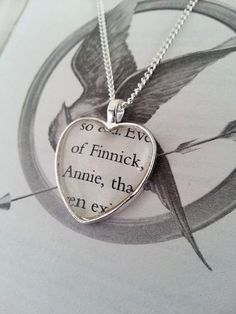 book page necklace with favorite couple  (mine would be Katniss and Peeta)