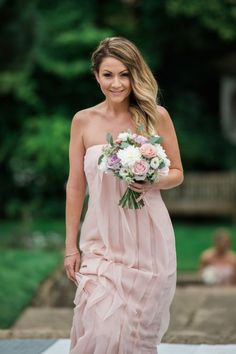Full-length pale pink strapless bridesmaids dress with ruffles. Dillington House wedding, Somerset.
