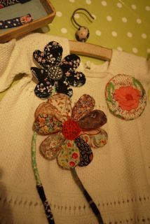 Flower pins. --Julie Arkell brooches