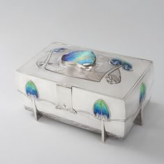 Archibald Knox (1864-1933) - For Liberty & Co. - Box. Polished Pewter and Enamel. Circa 1900.