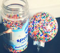Clear glass ornaments + varnish + candy sprinkles = way cool ornament!