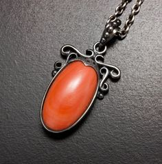 Oval cab coral pendant of patinaed silver by KAZNESQ on Etsy