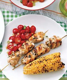 Chicken Kebabs with Tomato Salad|The simple, citrusy tomato salad wakes up garlicky grilled chicken, while fresh corn on the cob lends summer sweetness.    This receipe was simple and delicious!  Next time, I will probably put less oil into the tomatoes.  Besides that, it was a perfect grilling out meal!