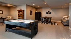 This downstairs game room is very open and includes a air-hockey table and a Dartboard.