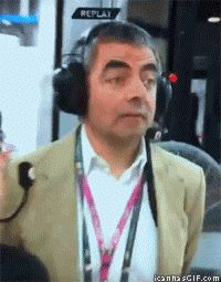 Mr. Bean watching a Formula 1 race