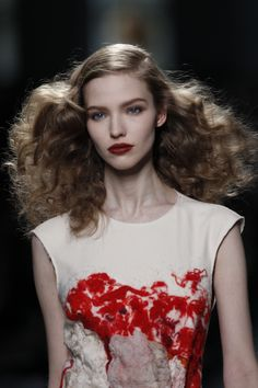 Go-to #hair stylist Guido Palau created this face-framing look for Botega Veneta's Milan #Fashion Week Fall 2013 runway show. The voluptuous curls were the perfect compliment to Pat McGrath's gorgeous burnt orange lip.