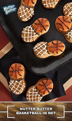 Peanut butter sandwich cookies are decorated to resemble bite-size basketballs in nets.  Score!