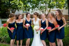 navy blue bridesmaids with coral bouquets and statement necklaces from Thea & Aaron's DIY, Creative Northern Virginia wedding