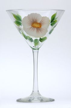 Beach roses and green leaves encircling a high quality 12 ounce martini glass.