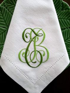 Machine embroidered monograms - I like the combo of dark and light green