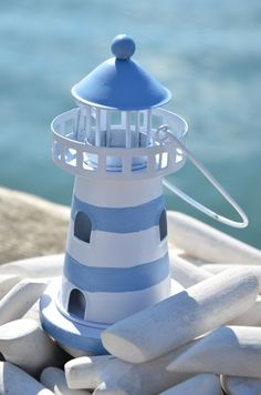 Lighthouse gifts - lighthouse models, novelty lighthouses, decorative lighthouses, wooden lighthouses, personalised lighthouses, quirky lighthouses, seaside and coastal decor in glass and other lighthouse ornaments from Dorset Gifts in the UK - hanging lighthouse ornaments and other nautical and maritime gifts for the nautical home, bathroom, garden or boat or as nautical window decor including lighthouse gifts, quirky lighthouse things. Lighthouse gifts for bathrooms.